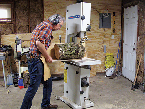 Sawing a bowl blank from a log at a band saw