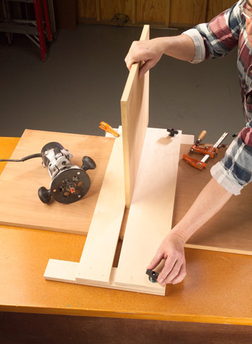 Squeeze a piece of the shelf material between the fixed and adjustable legs. Lock the adjustable leg in place.