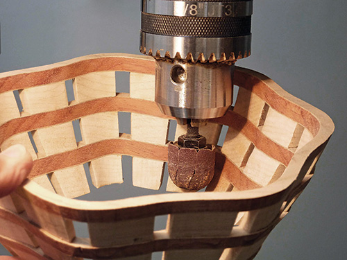 Sanding scroll sawn bowl interior with small inflatable sander