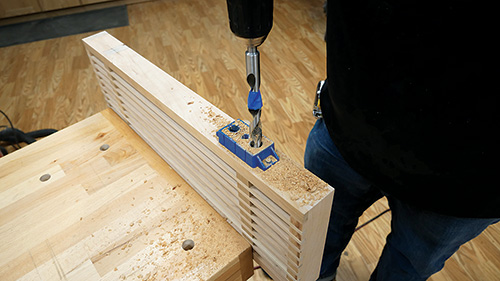 Using shelf support drilling jig to install rod holes