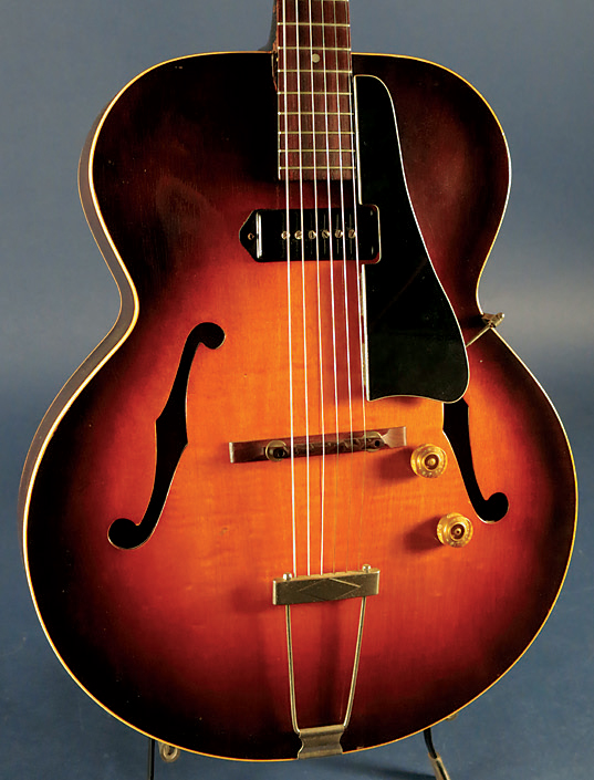 Color added around the edges of a sunburst finish intensifies the curve of an archtop guitar.