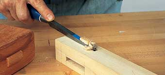 If you choose the full-depth method, you can lever out a big chip from the center of the mortise after the second drive of the chisel.